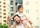 father's day. Dad and child daughter playing together outdoors