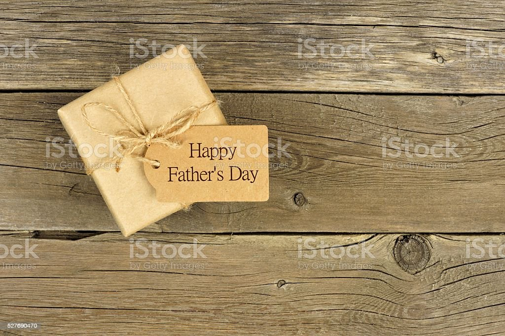 Fathers Day gift box with tag on rustic wood stock photo