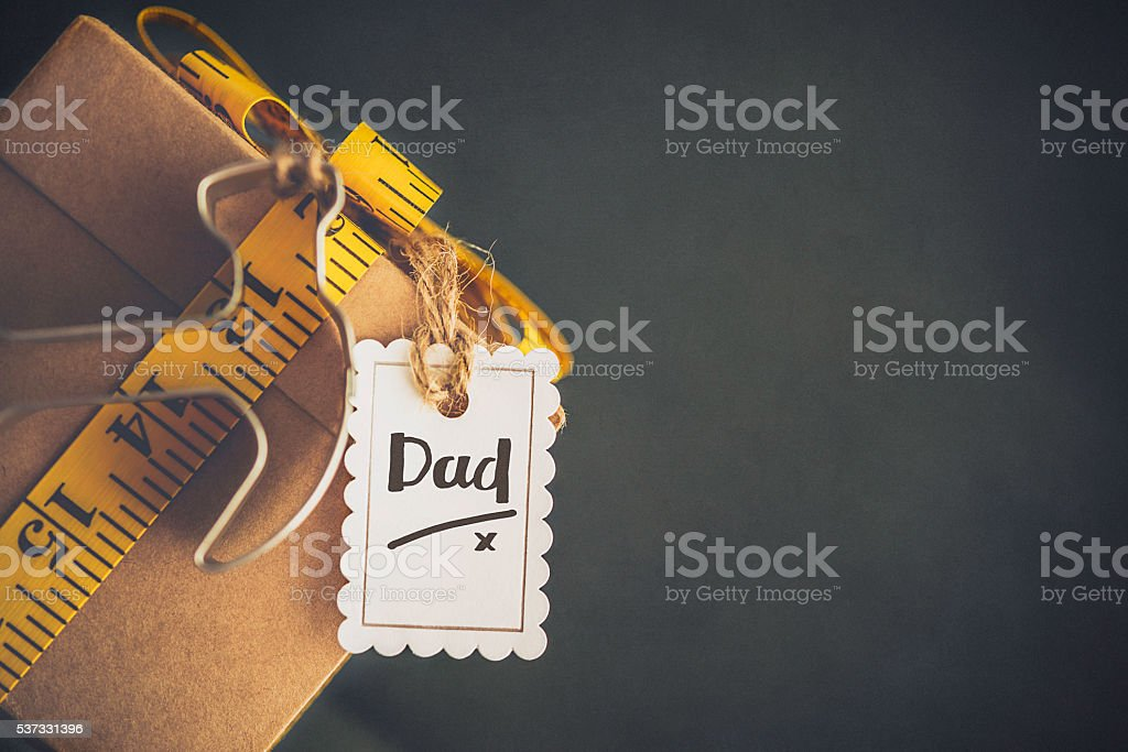 Father's Day gift for DIY dad with tape measure bow stock photo