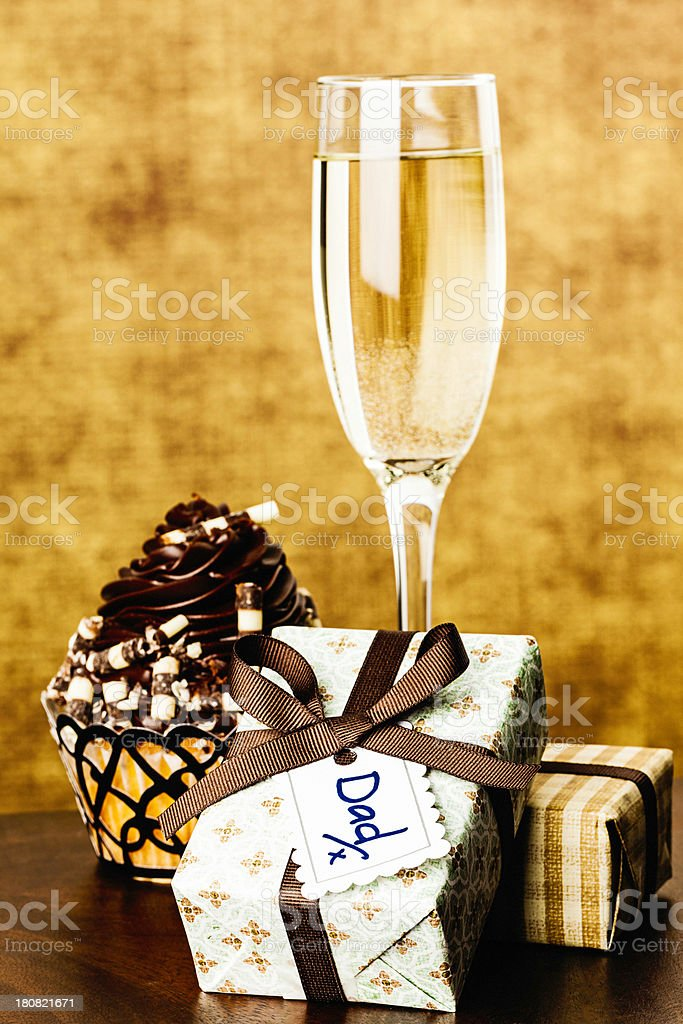 Father's Day Gifts with Gourmet Cupcake and Champagne royalty-free stock photo