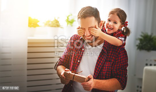 istock Father's day. Happy family daughter hugging dad and laughs 673115192