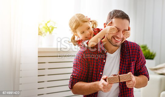 istock Father's day. Happy family daughter hugging dad and laughs 674991422