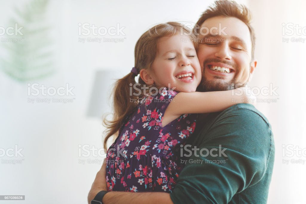 Father's day. Happy family daughter hugs his dad stock photo