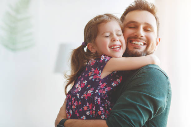 father's day. happy family daughter hugs his dad - embracing stock pictures, royalty-free photos & images