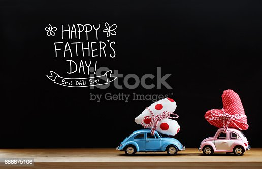 istock Fathers Day message with pink and blue cars 686675106