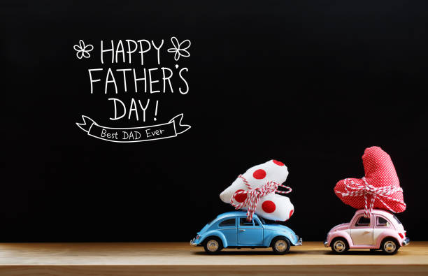 Fathers Day message with pink and blue cars stock photo