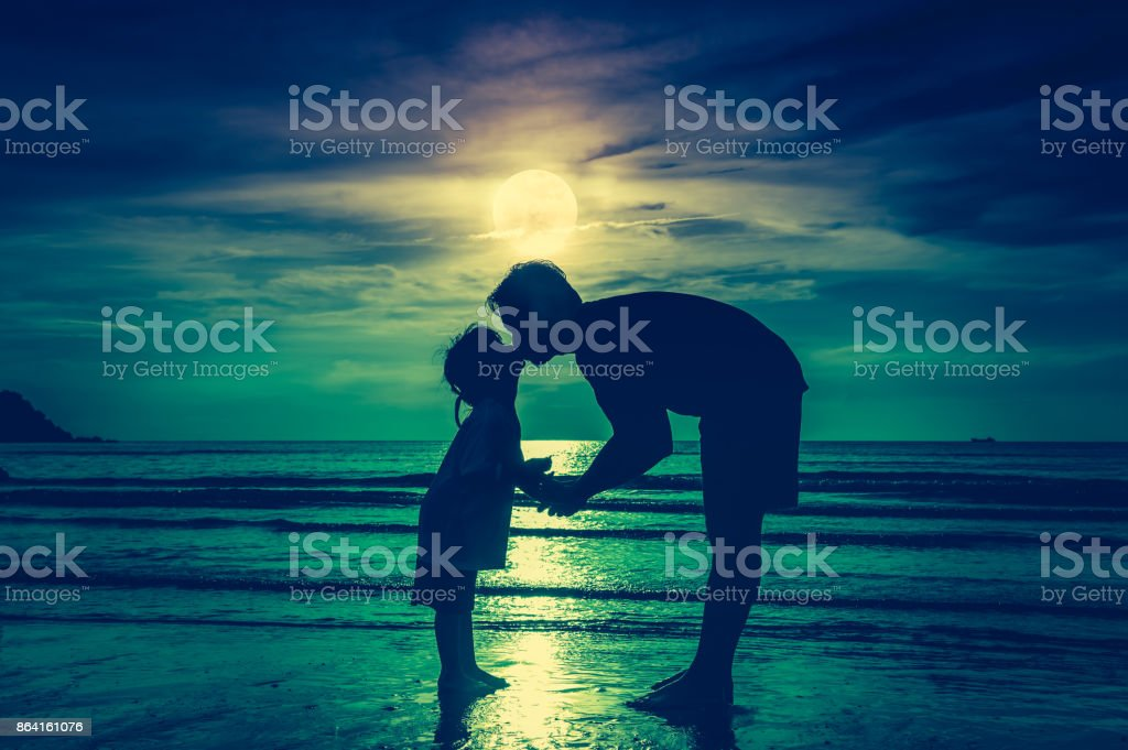 Father's day. Silhouette side view of loving child kissing her father. royalty-free stock photo