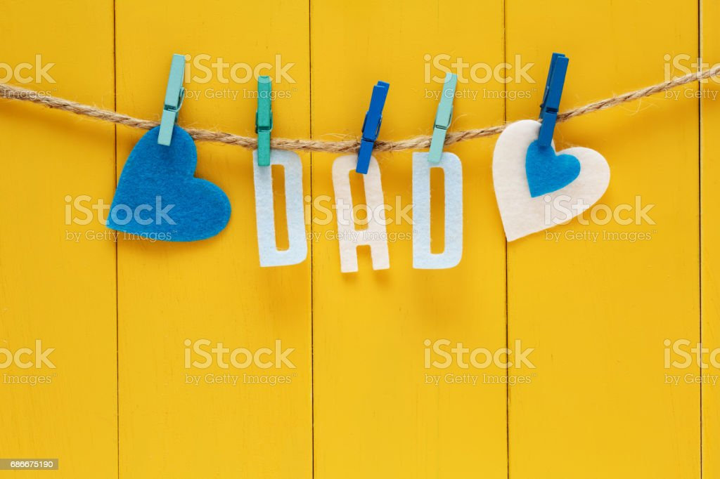 Fathers Day theme with hanging DAD letters stock photo