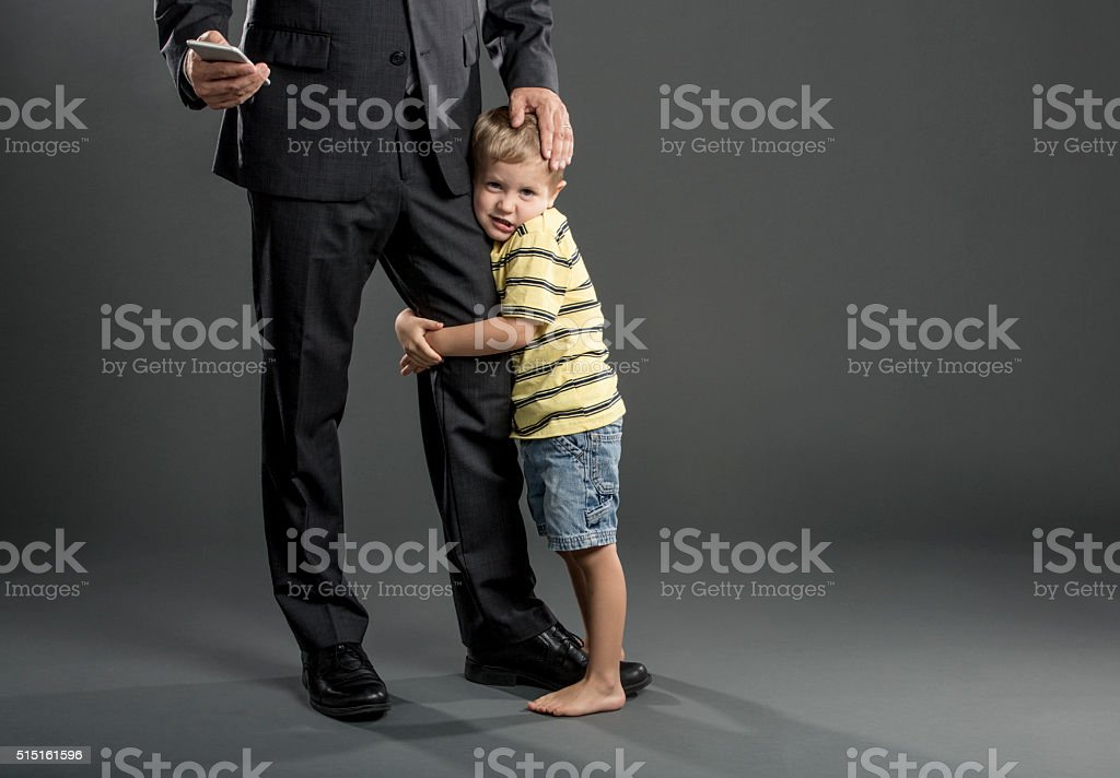 Father's Dueling Priorities stock photo
