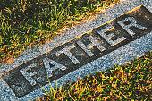 A father's gravestone.