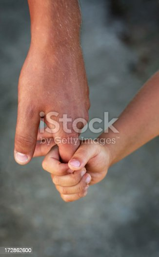 istock father's hand 172862600
