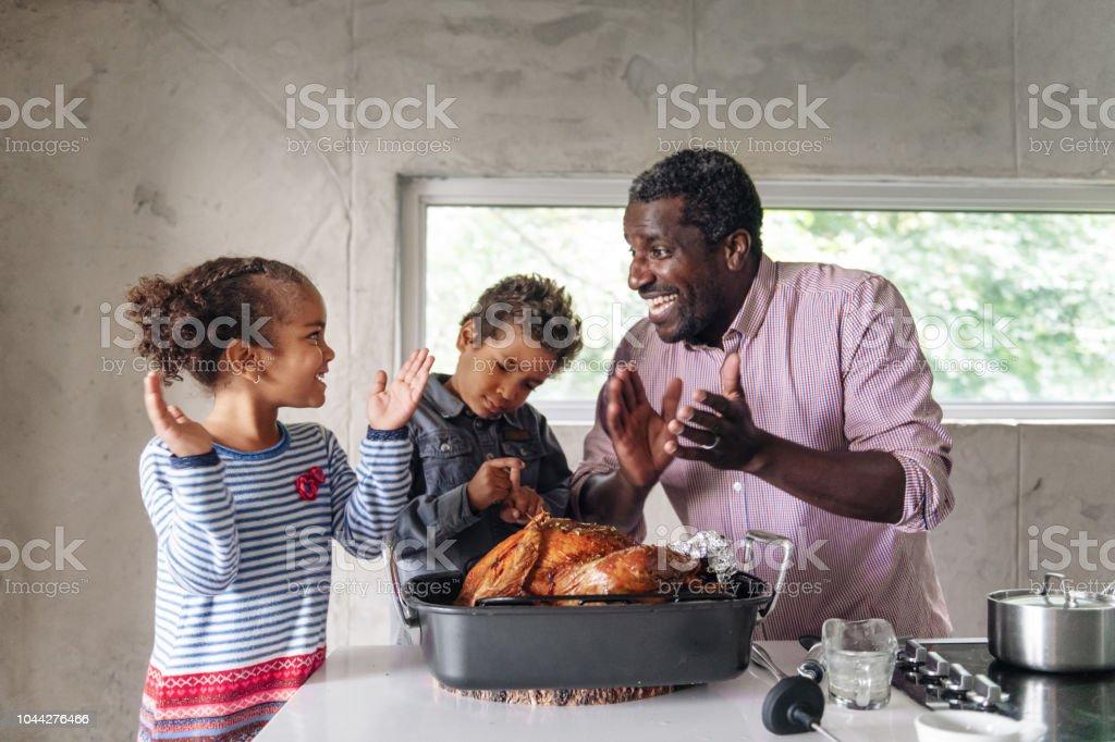 Fathers preparing thanksgiving turkey stock photo