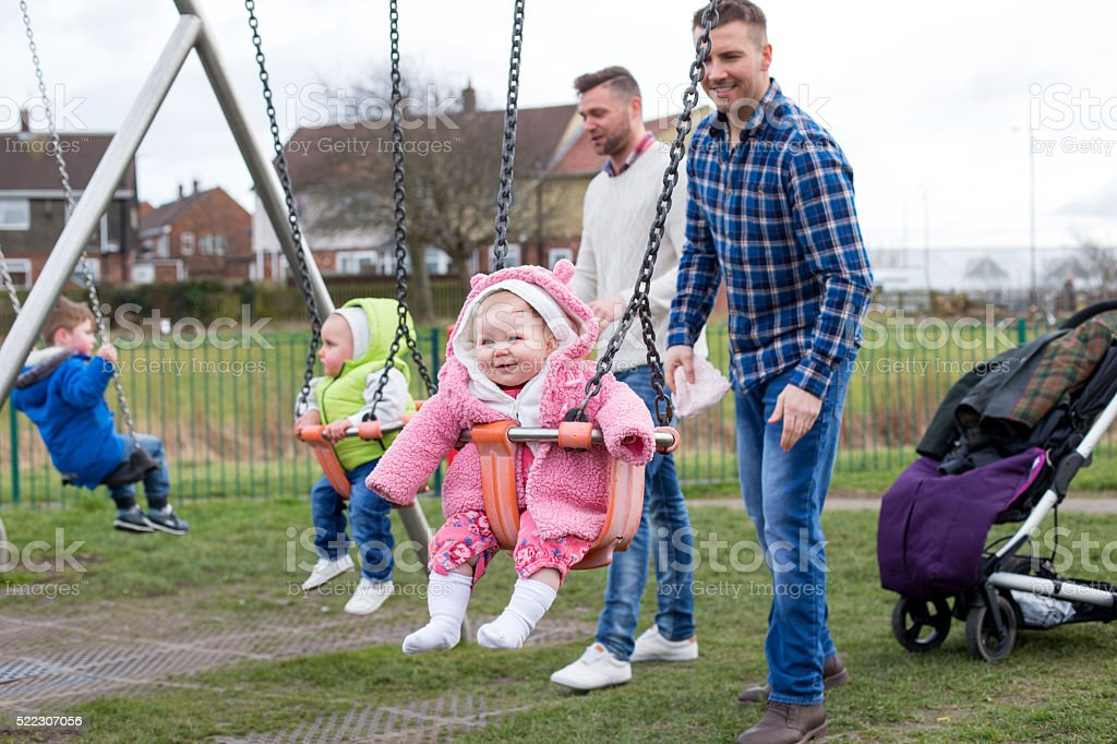 Fathers With Their Children At The Park stock photo