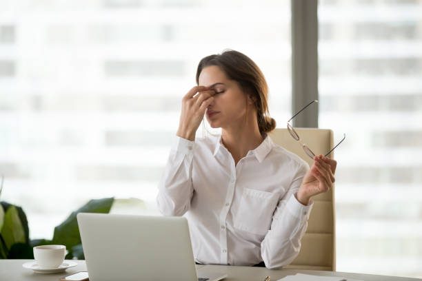 fatigued businesswoman taking off glasses tired of computer work - dry stock pictures, royalty-free photos & images