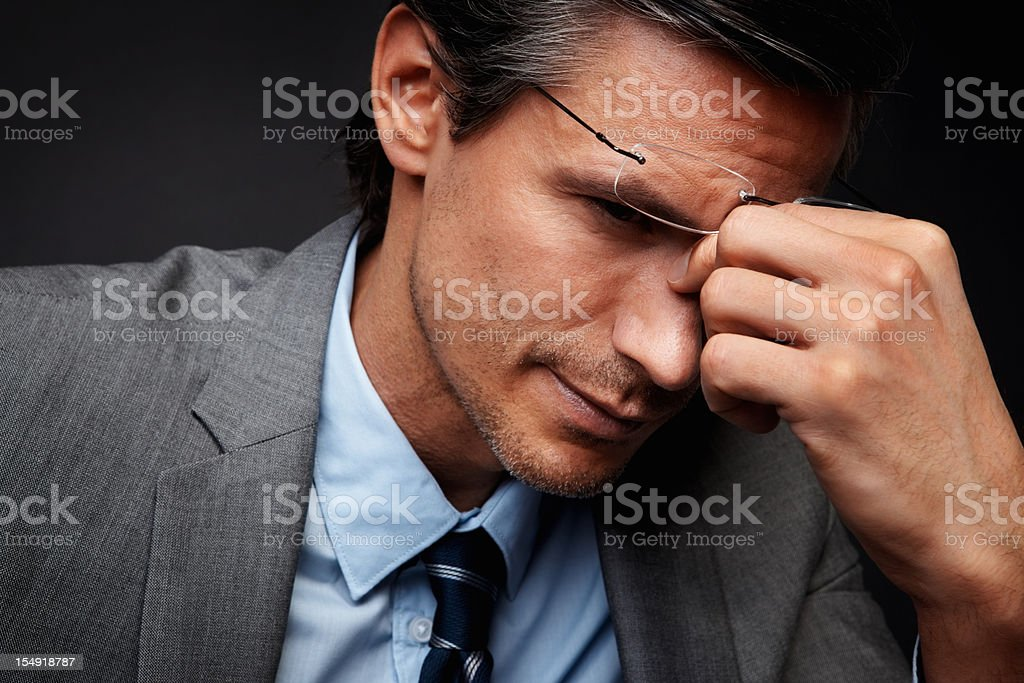 Fatigued executive deep in thought royalty-free stock photo
