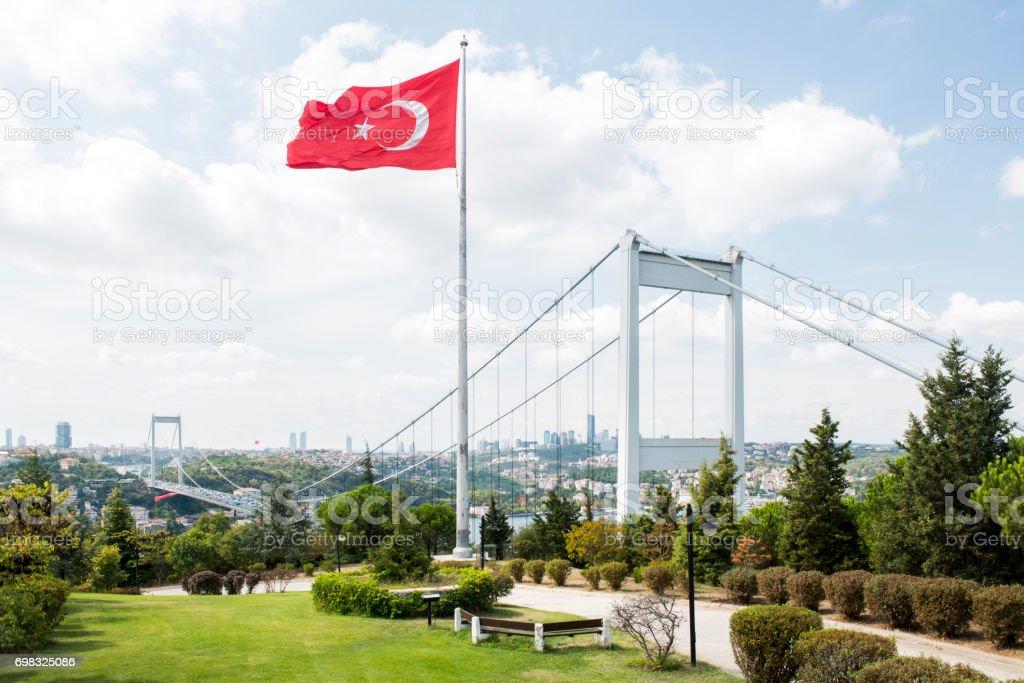 Fatih Sultan Mehmet Bridge and Turkish Flag in Istanbul, Turkey stock photo