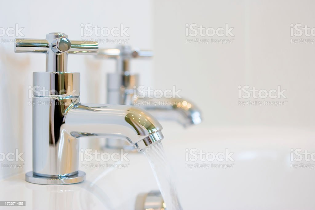 Faucet filling a bathtub with water royalty-free stock photo