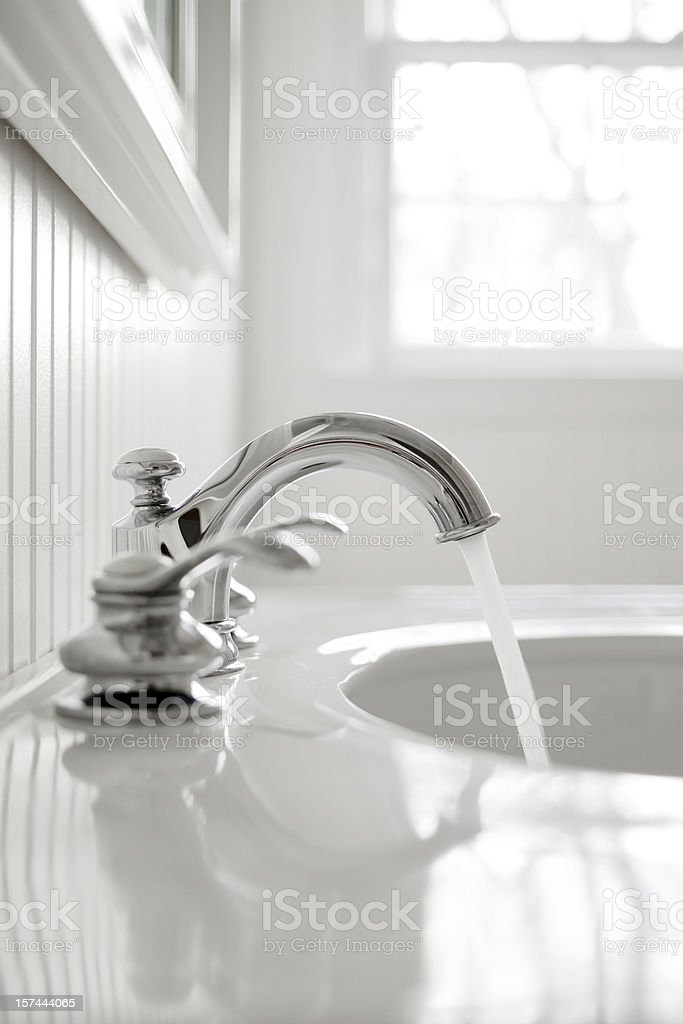 Faucet in a white bathroom stock photo
