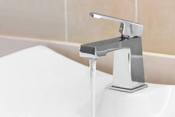 Faucet in bathroom stock photo