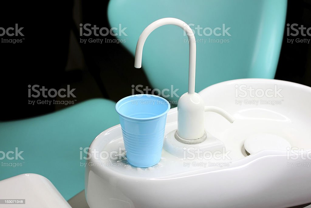 Faucet on dentist's chair royalty-free stock photo