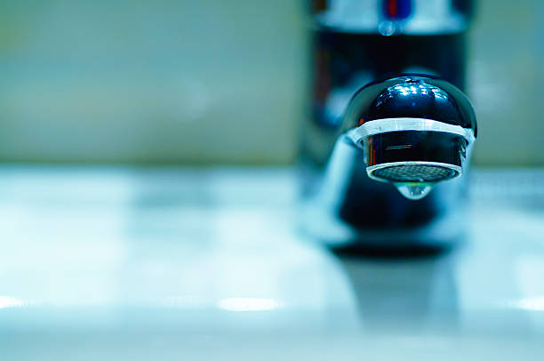 Faucet Detaill of a modern faucet head. dry stock pictures, royalty-free photos & images
