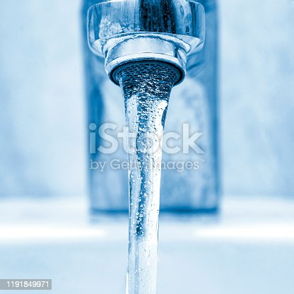 Faucet with flowing crystal clear water