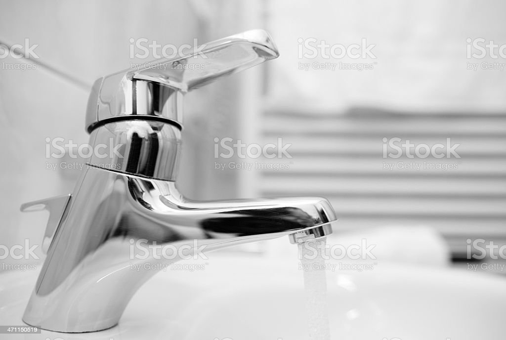 Faucet with flowing water royalty-free stock photo