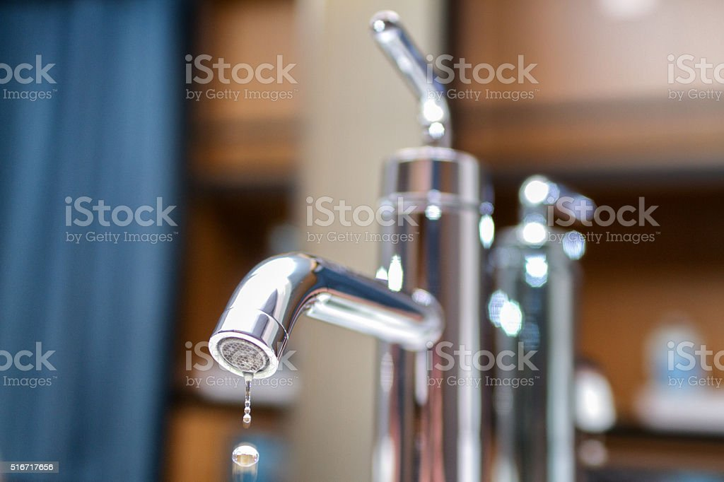 Faucet with Water Dripping Creating Waste stock photo