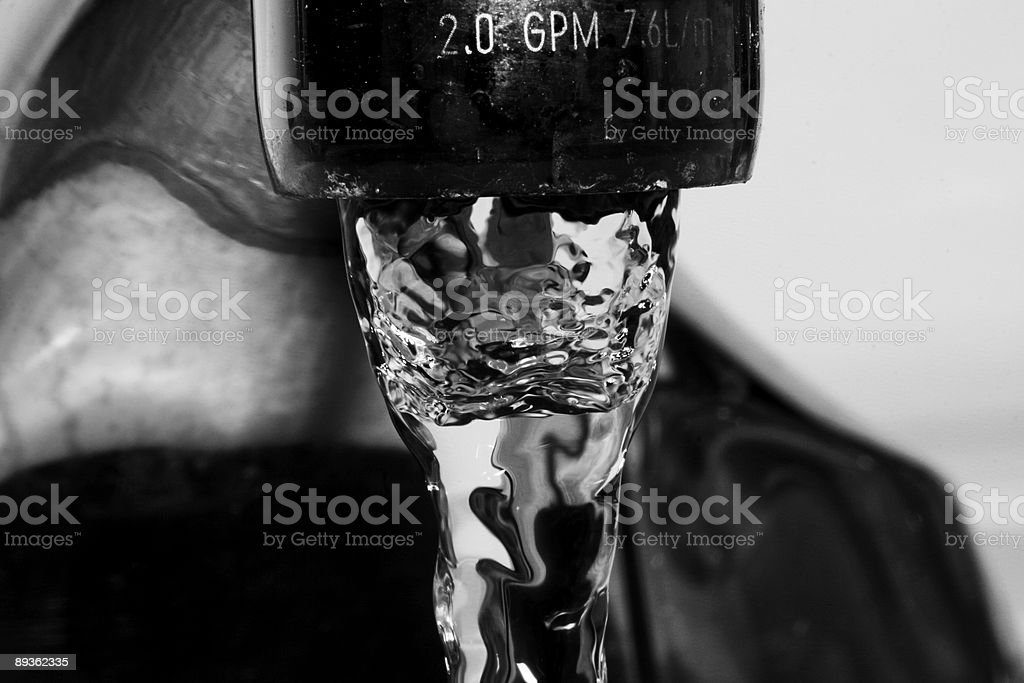 Faucet with water on royalty-free stock photo