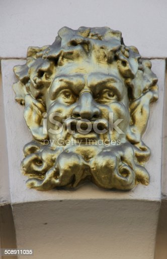 The face of a faun on a Paris wall.
