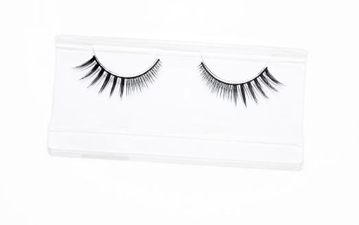 Artificial lashes on white background.
