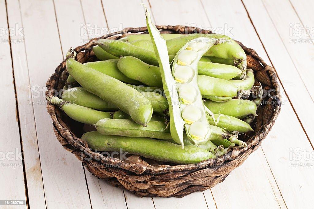 fava beans in basket open pod stock photo
