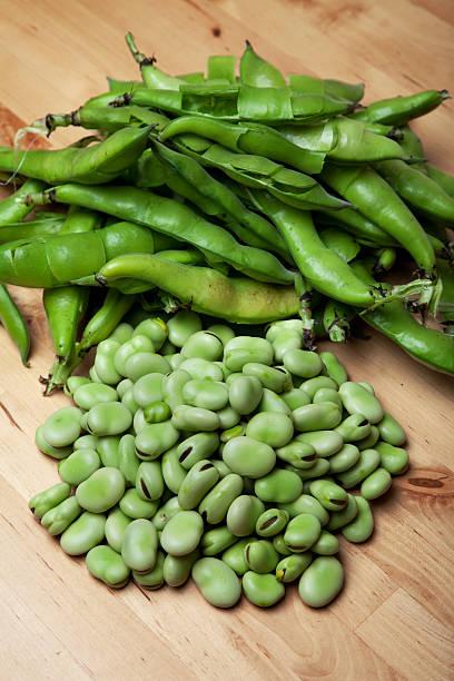 Fava Beans on table stock photo