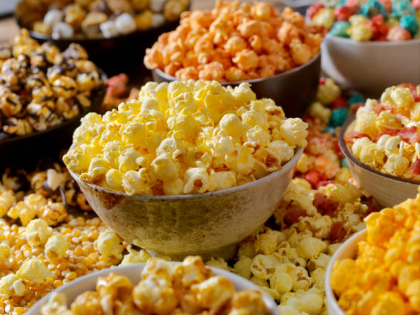 Favorite popcorn toppings, from maple bacon to Hot and Spicy stock photo