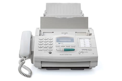 Retro fax machine isolated on white