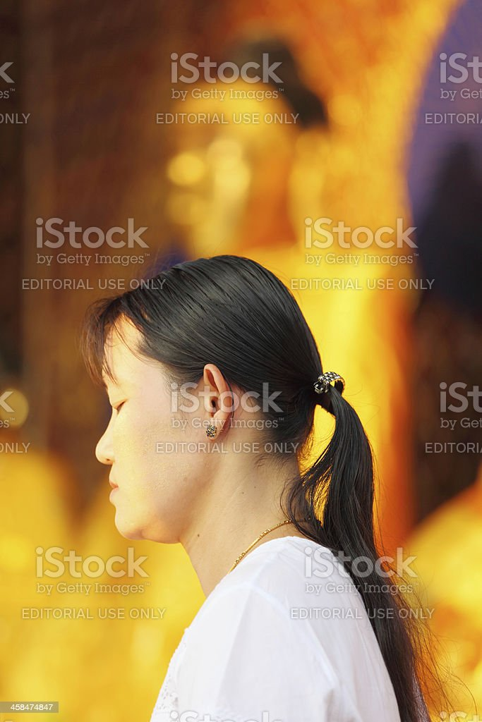 feale meditating buddhist pilgrim at Shwedagon pagoda royalty-free stock photo