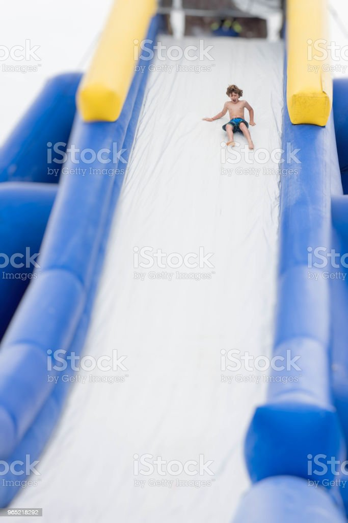 Fear and fun on a slide royalty-free stock photo