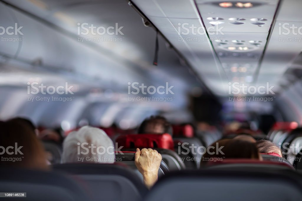 Fear of flying airplanes. Hand holding airplane seat. Fear of flying airplanes. Hand holding airplane seat. Adult Stock Photo