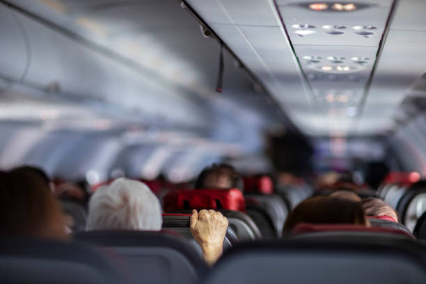 Fear of flying airplanes. Hand holding airplane seat. Fear of flying airplanes. Hand holding airplane seat. passenger stock pictures, royalty-free photos & images