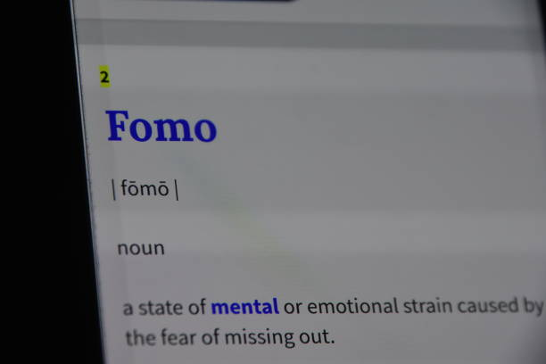 FOMO - Fear of Missing Out...social networking problem FOMO - Fear of Missing Out facebook boycott stock pictures, royalty-free photos & images