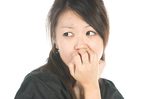 Fear Asian woman looking scared. shocked asian woman stock pictures, royalty-free photos & images