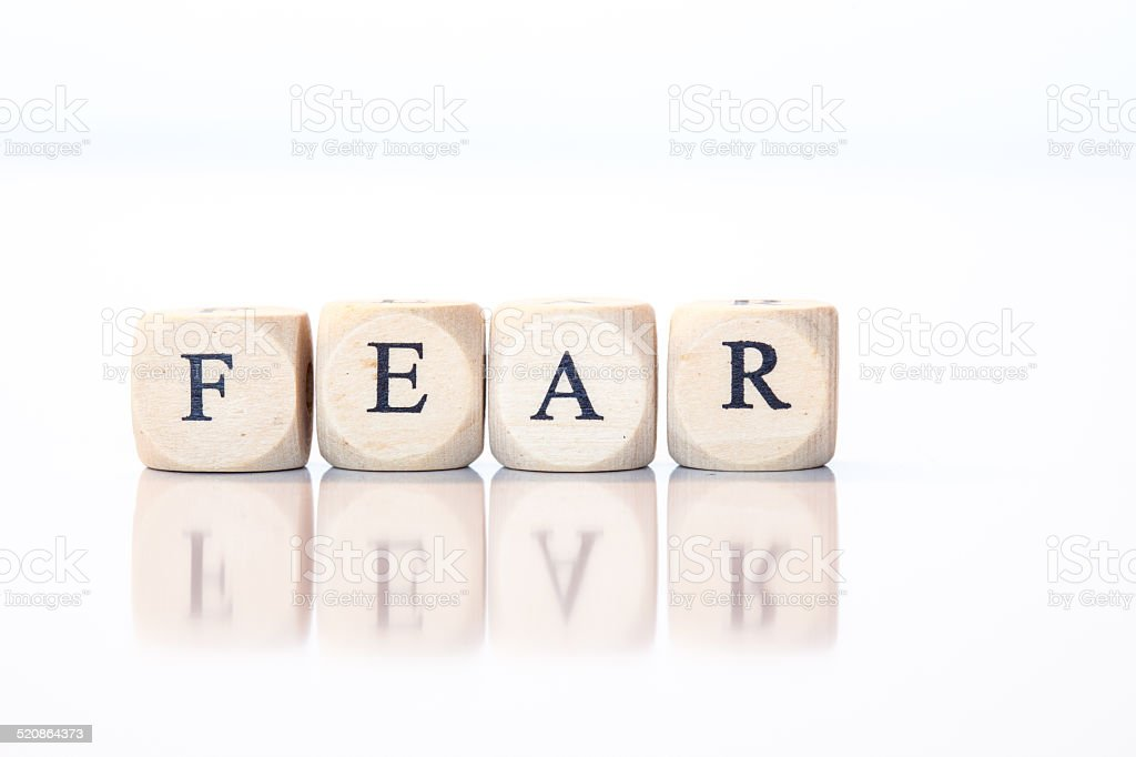 Fear, spelled with dice letters stock photo