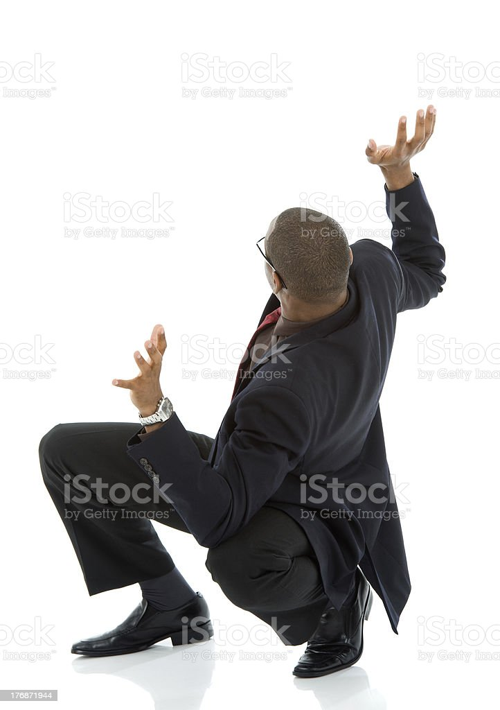 Fearful Black Business Man Startled and Leaning Backwards royalty-free stock photo