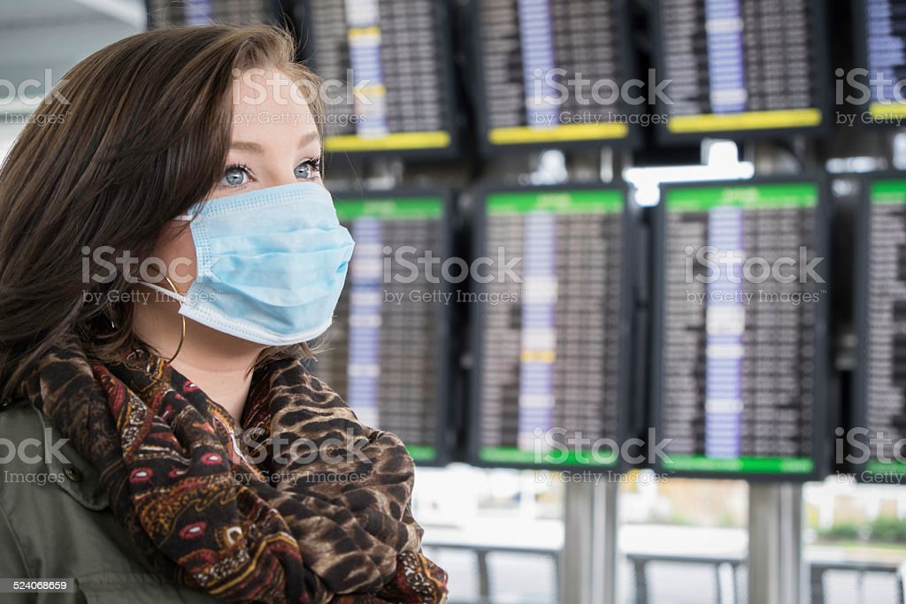 Fearful Passenger Wears Mask at the Airport stock photo