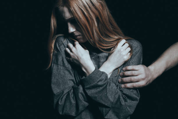 Fearful rape victim stock photo