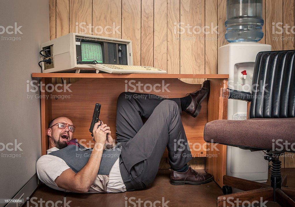 fearful scared gun weilding office worker 1980's computer style royalty-free stock photo