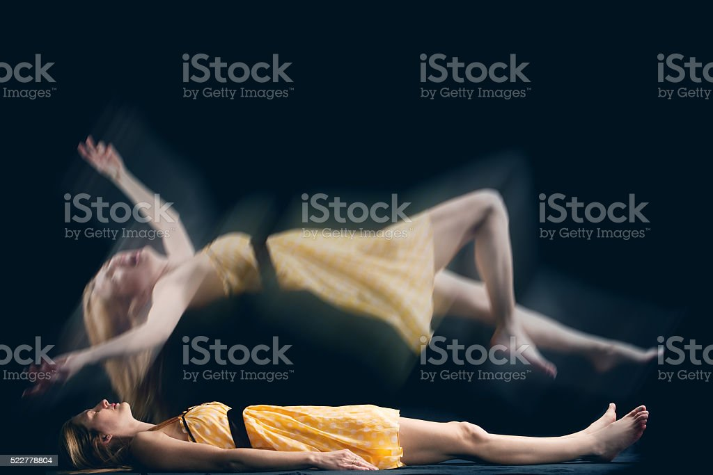 Fearful Spirit Of Woman Leaving Her Body stock photo