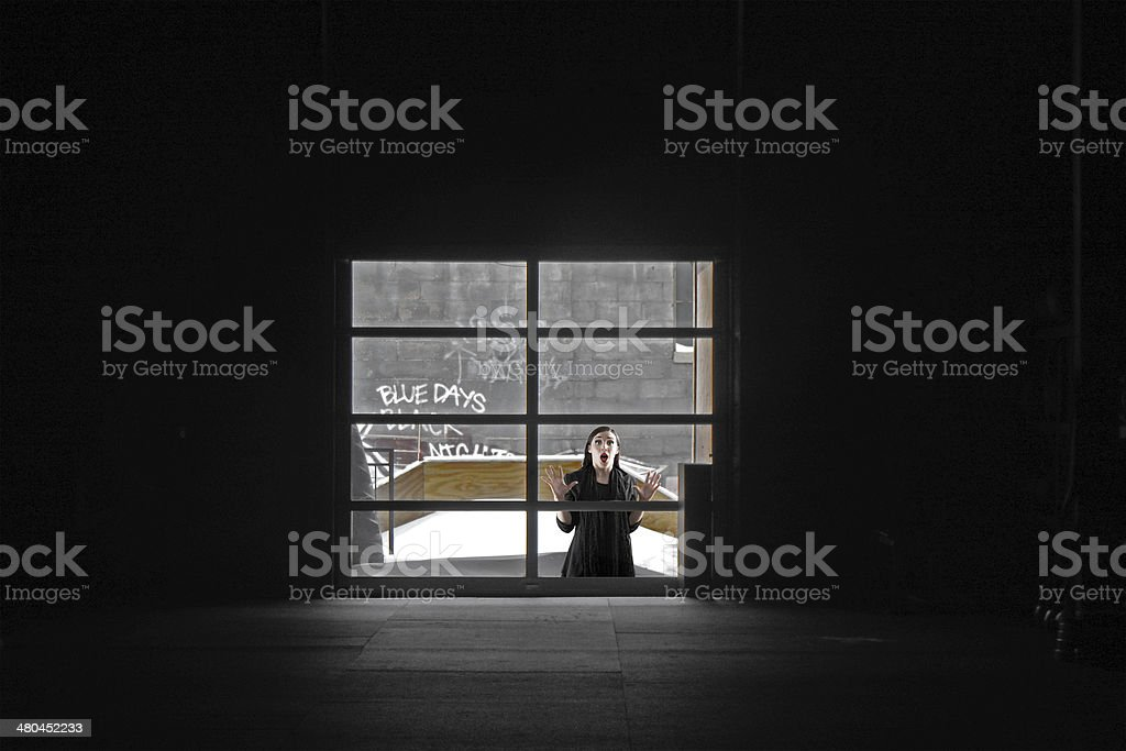 Fearful Woman Trapped Outside stock photo