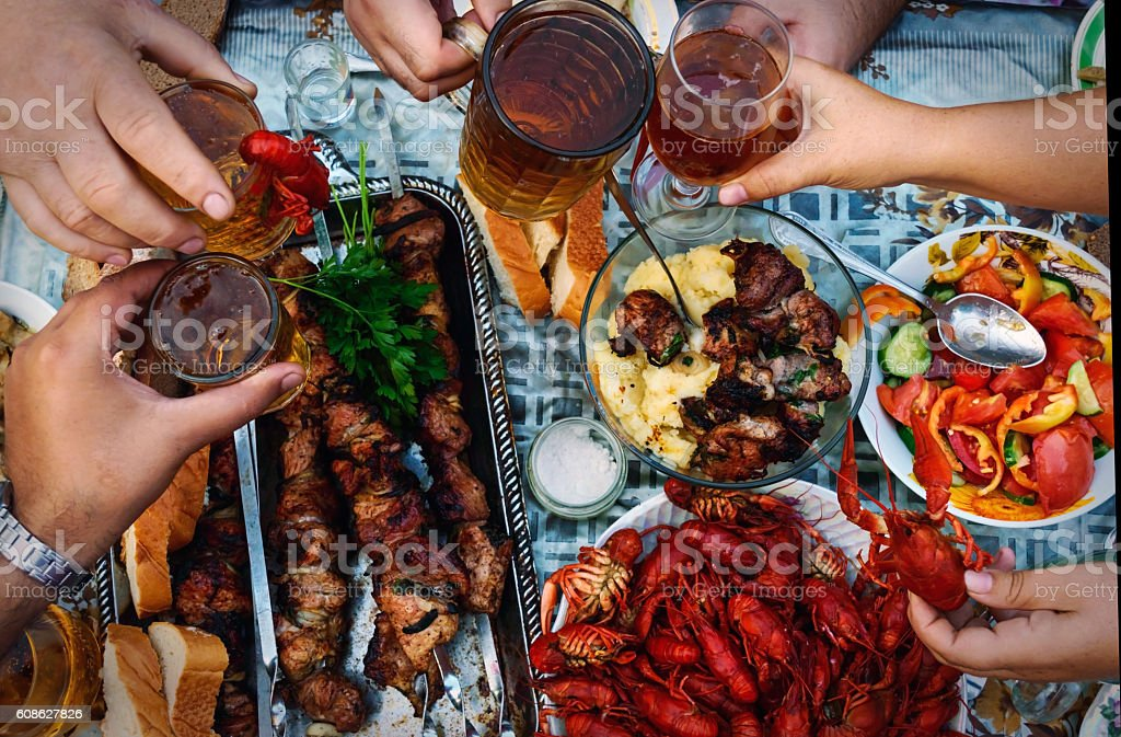 Feast of beer, meat skewer and crayfish. stock photo