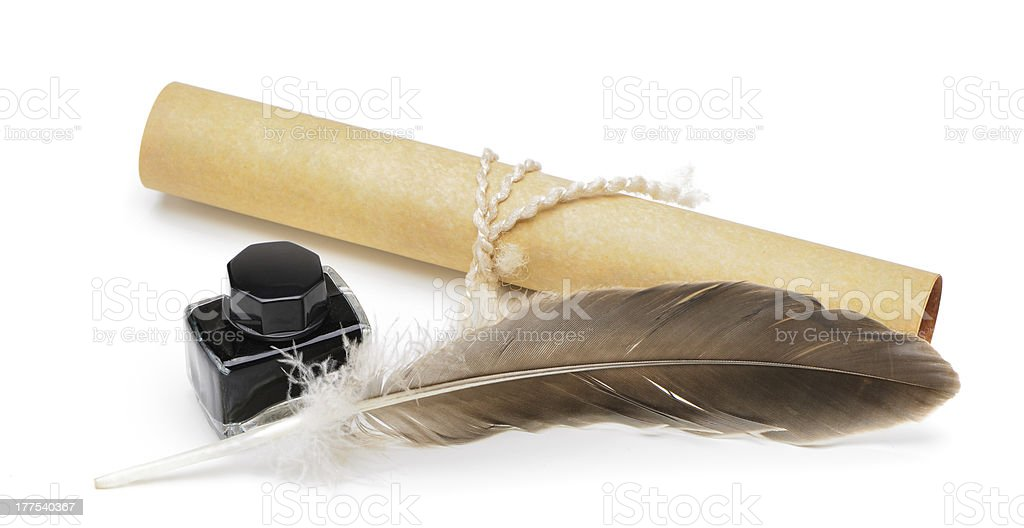 feather pen, ink,rolls of old yellowed paper royalty-free stock photo